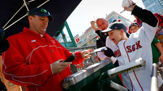 A young fan enters Fenway Park in Boston.
