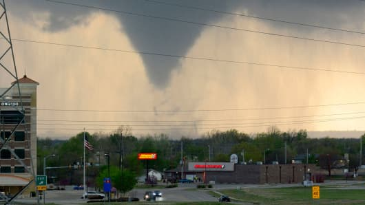 A tornado touches down in Tulsa, Okla., on Wednesday, March 30, 2016.