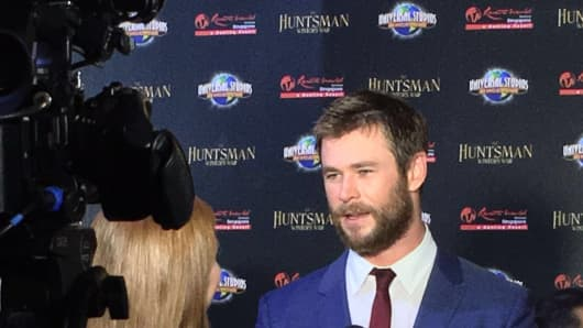 Eric the Huntsman actor Chris Hemsworth speaks to a reporter on the red carpet.