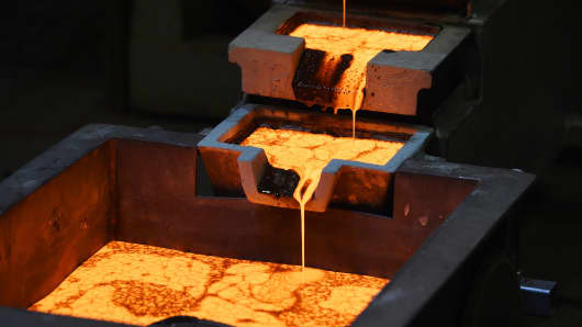 Molten gold is poured into molds at the Norton Gold Fields Paddington operations near Kalgoorlie, Australia.