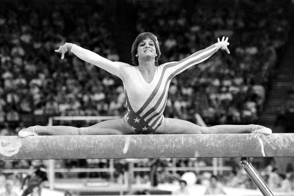 In this Aug. 3, 1984, file photo, Mary Lou Retton, of the United States, performs on the balance beam during the women's gymnastics individual all-around finals at the XXIII Summer Olympic Games in Los Angeles.