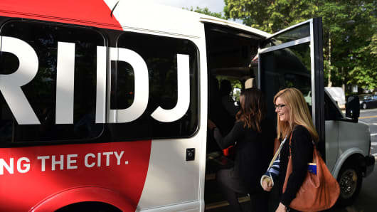 A woman boards a Bridj bus in Washington, D.C.