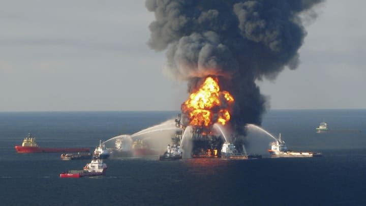 Fire boat response crews battle the blazing remnants of the offshore oil rig Deepwater Horizon, off Louisiana, in this April 21, 2010