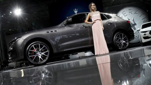A model poses with the Maserati Levante SUV during the 2016 New York International Auto Show in New York, March 23, 2016.