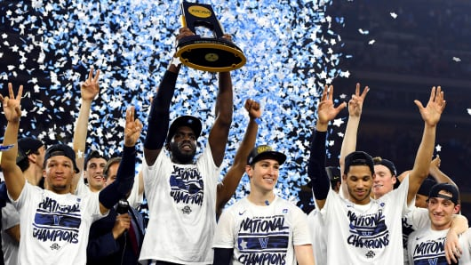 Villanova Wildcats forward Daniel Ochefu (23) celebrates with the National Championship Trophy after beating the North Carolina Tar Heels in the championship game of the 2016 NCAA Men's Final Four at NRG Stadium.