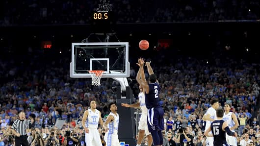 Kris Jenkins #2 of the Villanova Wildcats shoots the game-winning three pointer to defeat the North Carolina Tar Heels 77-74 in the 2016 NCAA Men's Final Four National Championship game at NRG Stadium on April 4, 2016 in Houston, Texas.
