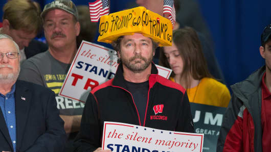 Charlie Wicka (C) listens as Republican presidential candidate Donald Trump speaks to guests during a campaign stop at the La Crosse Center on April 4, 2016 in La Crosse, Wisconsin.