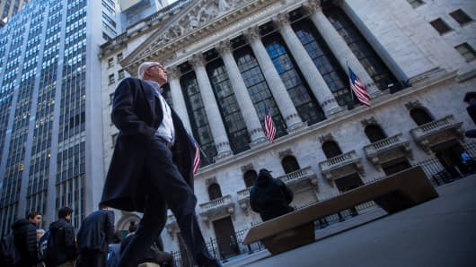A pedestrian walks outside the New York Stock Exchange.