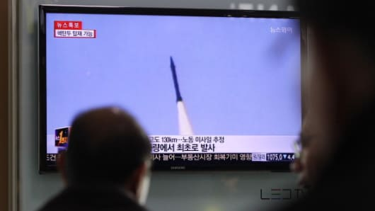 People watch a television broadcast reporting the North Korean missile launch at the Seoul Railway Station on March 26, 2014 in Seoul, South Korea.