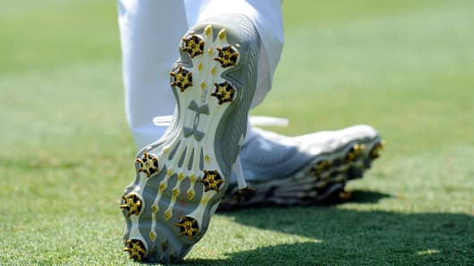 Golfer Jordan Spieth wearing Under Armour footwear.