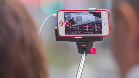 A selfie stick, being used on documenting the 29th Kawasaki Awaodori Dance Festival at an audience seat near the Kawasaki Station.