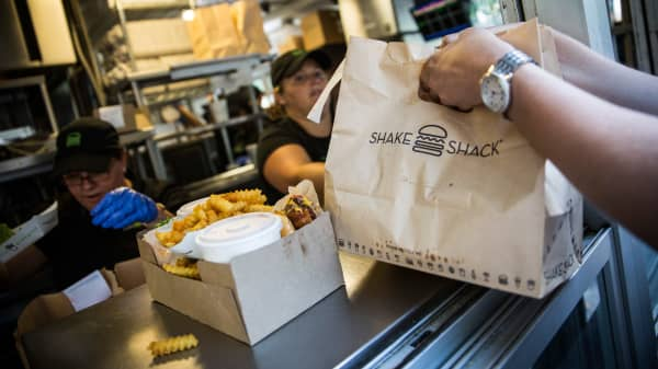 Customers pick up their orders from Shake Shack.