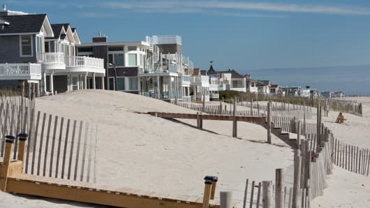 Ocean front homes stand along the beach on Long Beach Island in Long Beach Township, New Jersey