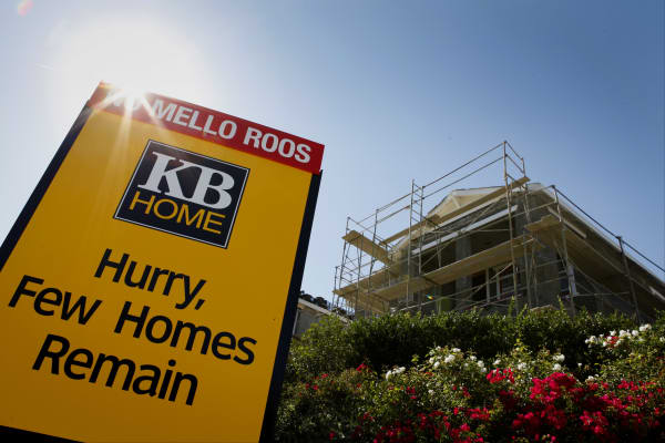 A KB Home sign stands in front of a house under construction at the Whisler Ridge housing community in Lake Forest, California, U.S.