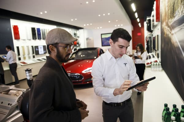 An employee assists a customer with pre-ordering the Tesla Motor Model 3 in Santa Monica, California, last March.