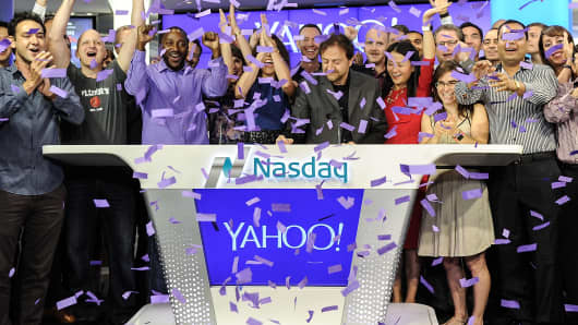 Chief Revenue Office of Yahoo Lisa Utzschneider, Senior Vice President of Yahoo Simon Khalaf and Principal Technologist at Nasdaq Mike Viola pose while Yahoo!, Inc rings The NASDAQ Opening Bell at NASDAQ on August 26, 2015 in New York City.