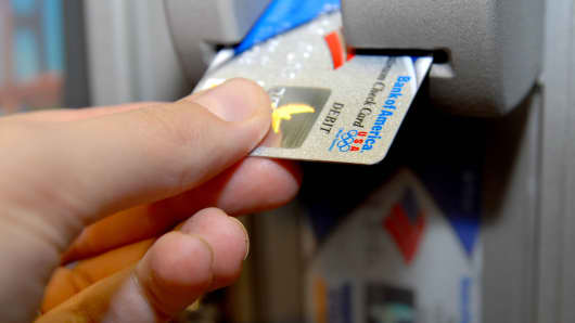 A Bank of America customer uses a bank card