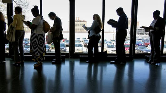 Job seekers stand in a line at a career fair in Chicago.
