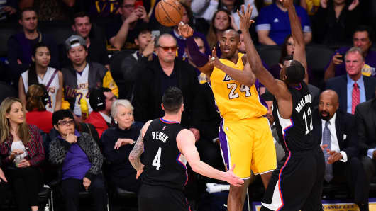 ctor Jack Nicholson watches from his courtside seat as Kobe Bryant of the Los Angeles Lakers shoots under pressure from Luc Richard Mbah a Moute of the Los Angeles Clippers during their NBA game on April 6, 2016 at Staples Center in Los Angeles, California.