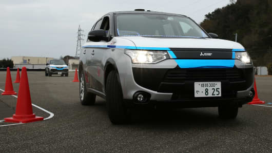 A Mitsubishi Electric Corp. self-driving vehicle travels though a test course during a demonstration.