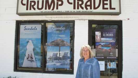 Claudia Rabin-Manning stands outside her Baldwin, N.Y. business, Trump Travel. Rabin-Manning says she has been the target of legal action from Republican presidential candidate Donald Trump over the use of the name Trump Travel.