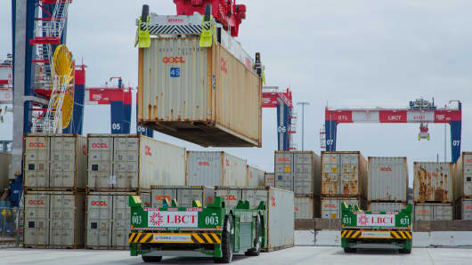 Containers are loaded onto automated guided vehicles (AGV) during the testing phase of the Long Beach Container Terminal in Middle Harbor at the Port of Long Beach in Long Beach, California.