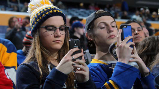 Fans of the Buffalo Sabres use their smartphones before an NHL game against the Washington Capitals on January 16, 2016 at the First Niagara Center in Buffalo, New York.