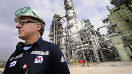 Don Robicheaux, safety coordinator for Marathon, stands in front of a crude unit, part of Marathon's estimated $3.2 billion expansion in Garyville, La.