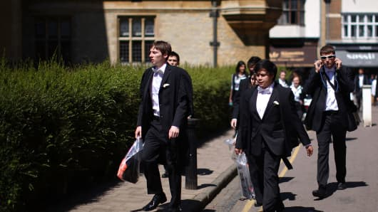 Oxford University students arrive at the Exam Schools building to take examinations