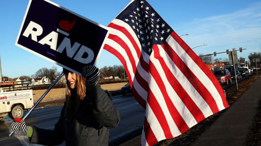 Supporters of Republican presidential candidate Rand Paul campaign for their candidate February 1, 2016 in Des Moines, Iowa.