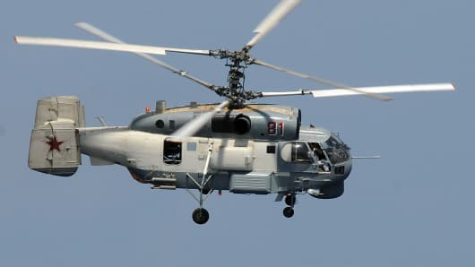 A Russian Helix KA-27 helicopter flies near the guided-missile cruiser USS Vella Gulf while conducting operations in the Gulf of Aden, in this U.S. Navy picture taken February 9, 2009. Two Russian warplanes flew simulated attack passes April 12 near the U.S. destroyer USS Donald Cook and were followed by seven passes by Russian KA-27 Helix helicopter taking pictures, a U.S. official said.