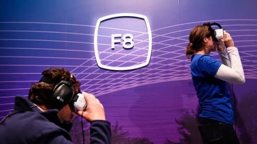 Attendees try out Gear VR glasses during the Facebook F8 Developers Conference in San Francisco, April 12, 2016.