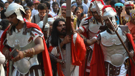 Sri Lankan Catholics re-enact the crucifixion of Jesus Christ on Good Friday at St. Peter's Church in Negombo on March 25, 2016.