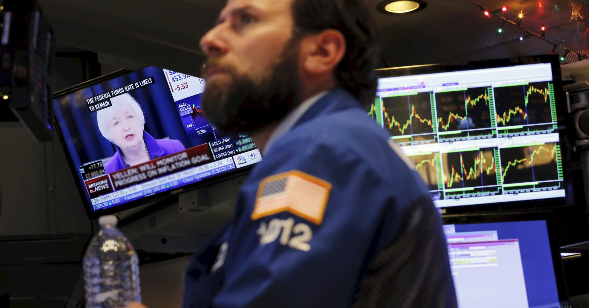 A trader works on the floor of the New York Stock Exchange as Janet Yellen holds a press conference on Dec. 16, 2015.