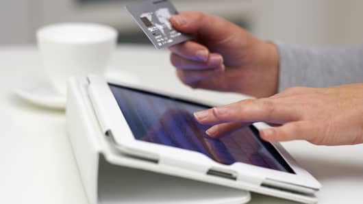 Online Shopping on tablet with credit card