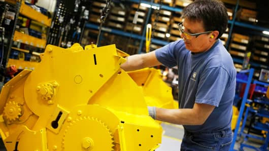 A worker assembles components for a New Holland round baler at the company's Haytools factory in New Holland, Pennsylvania, April 8, 2016.