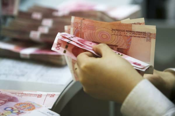A clerk of ICBC bank counts Chinese 100 yuan at its branch in Beijing.