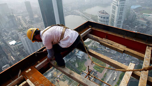 A Chinese construction worker at a skyscraper building site in Wuhan, central China's Hubei province.