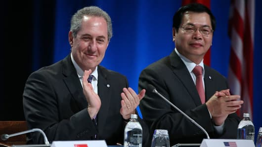 U.S. representative Michael Froman and Vietnam Minister Vu Huy Hoang celebrates the after the signing of the Trans Pacific Partnership at Sky City on February 4, 2016 in Auckland, New Zealand. Countries are now in the process of ratifying the agreement.