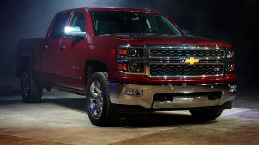 gm dips after reported suit alleges diesel pickups are rigged to pass emissions tests. Black Bedroom Furniture Sets. Home Design Ideas