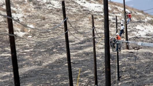 Repairing telephone poles