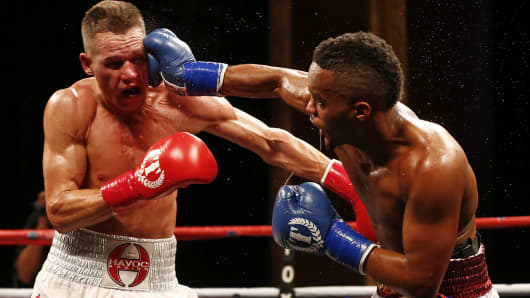 Jason Litzau, left, is hit with a right punch in the face by Hylon Williams during their bout in the season two finale of NUVOtvÕs Knockout at Foxwoods Resort Casino on August 16, 2015 in Mashantucket, Connecticut. The match ended in a draw.