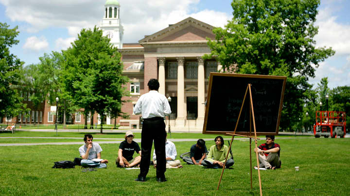 A group of students meet on the lawn outside Webster Hall on the campus of Dartmouth College in Hanover, New Hampshire.