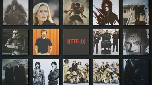 Promotional images of Netflix Inc. programs are displayed on a wall at the Netflix Japan office in Tokyo, Japan.