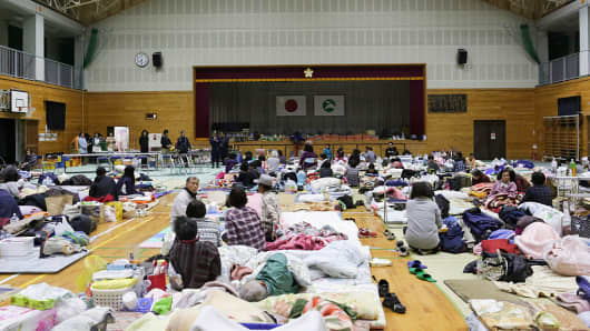 Local residents who had to evacuate their houses after the earthquake gather at Kawahara elementary school on April 17, 2016 in Nishihara, Kumamoto, Japan.