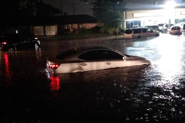 Floods in Houston, Texas. A car drives in flood water in Houston, Texas on Friday, April 17, 2015.