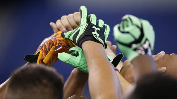 General view of Under Armour gloves as players huddle