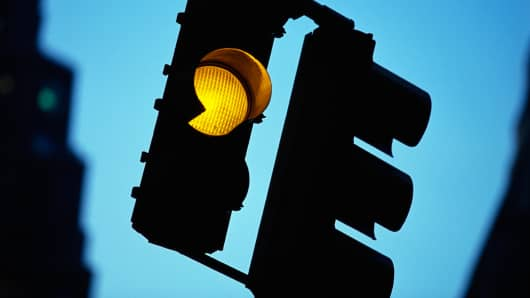 Slow down yellow traffic light