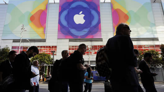 The Apple Inc. logo is displayed outside as attendees line up to enter the Moscone Center before the start of the Apple Worldwide Developers Conference (WWDC) in San Francisco.