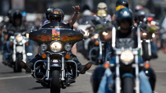 Harley Davidson bikers parade during a Harley meeting in Copacabana beach, in Rio de Janeiro.
